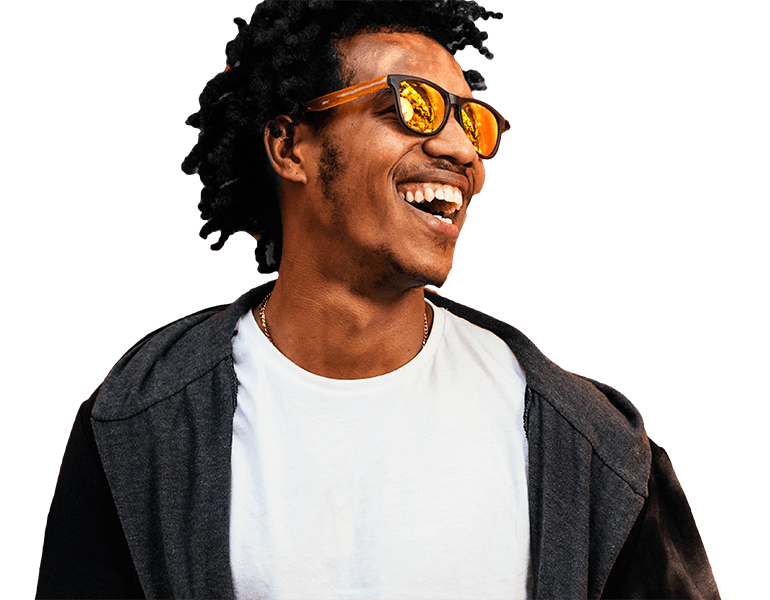 African man smiling wearing sunglasses | Msafiri magazine
